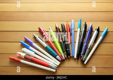 Ballpoint Pens on Wooden Background - Stock Photo