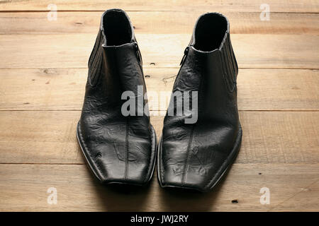 Boots on Wooden Background - Stock Photo