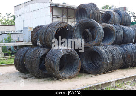 Thin metal reinforcement with corrugation wound into bays at the metal products warehouse, Russia - Stock Photo