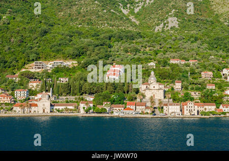 Prcanj - a small town along the Bay of Kotor, Montenegro. A part of the waterfront, that consists of a long line - Stock Photo