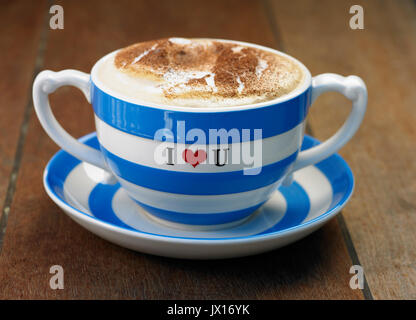 cappuccino coffee in large blue and white mug with cinnamon  i love you - Stock Photo