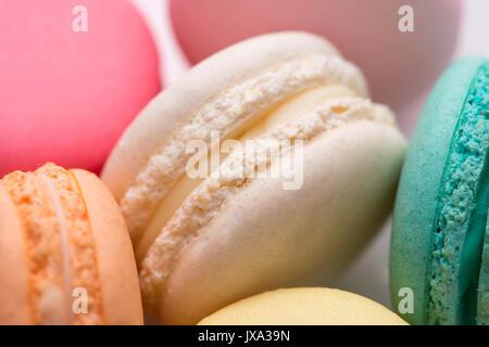 Closeup of colorful pastel macaroons. Sweet macarons. - Stock Photo