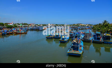Phan Thiet, Vietnam - Mar 25, 2017. Fishing boats at pier in Phan Thiet, Vietnam. Phan Thiet is the capital of Binh - Stock Photo