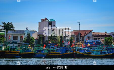 Phan Thiet, Vietnam - Mar 26, 2017. Fishing boats docking at pier in Phan Thiet, Vietnam. Phan Thiet is located - Stock Photo