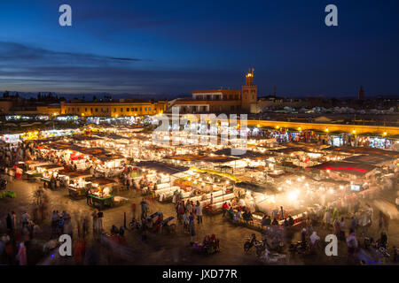 Jamaa el Fna market square at dusk, Marrakesh, Morocco, north Africa. - Stock Photo