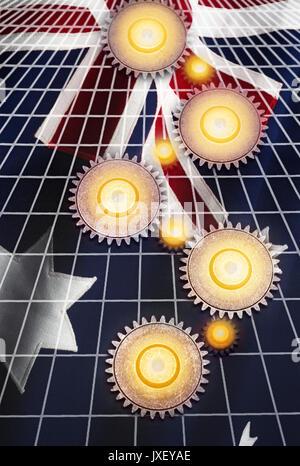 INTERLOCKING COG GEARS ON GRID OVER FLAG OF AUSTRALIA - Stock Photo