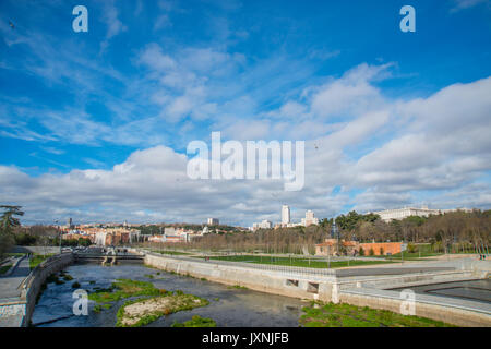 River Manzanares and view of the city from Segovia bridge. Madrid, Spain - Stock Photo