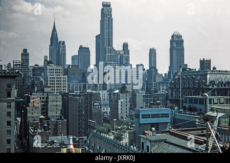 View looking across buildings in New York City in 1956. Signs can be seen for Hotel Knickerbocker, King Edward Hotel, - Stock Photo
