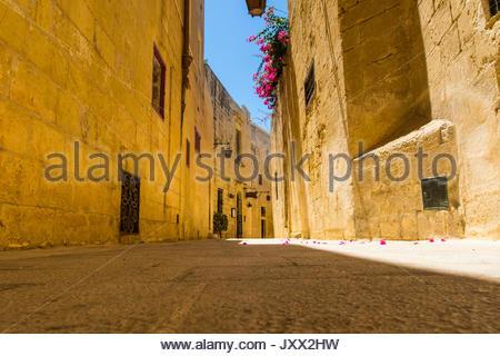 narrow lane in mdina, malta - Stock Photo