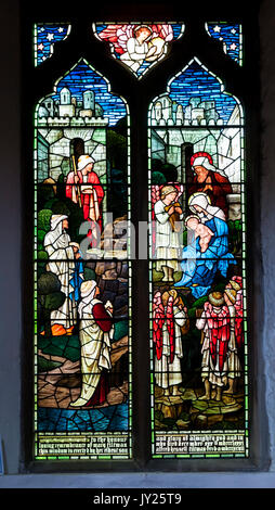 Stained glass window memorial to Mary Tiltman, designed by Burne-Jones, in St Mary's church, Rye, East Sussex. - Stock Photo