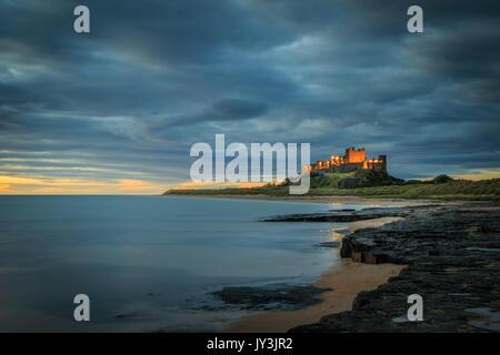 Bamburgh castle sunrise on the Northumberland coastline - Stock Photo