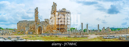 Panoramic view of Perge with columns of Agora and broken towers of Hellenistic City Gate, Antalya, Turkey. - Stock Photo