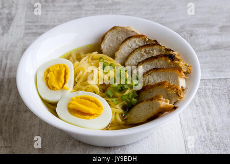 japanese ramen soup with chicken and boiled egg in white bowl - Stock Photo