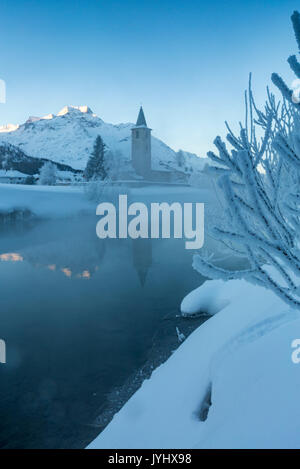 Foggy sunrise in winter. Sils Maria, Sils im Engadin, Graubunden, Switzerland. - Stock Photo