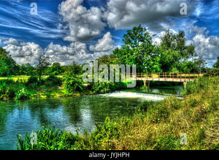 Footbridge over the river Avon in north Wiltshire, (processed as an hdr image). - Stock Photo