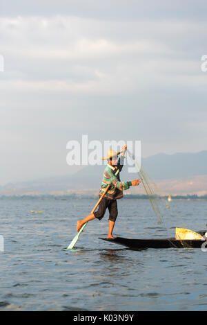 Inle lake, Nyaungshwe township, Taunggyi district, Myanmar (Burma). Local fisherman on the edge of the boat. - Stock Photo