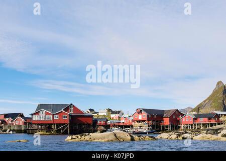Red wooden fishermen's huts and buildings on stilts by water in fishing village of Å, Moskenes, Moskenesøya Island, - Stock Photo