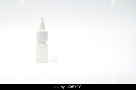 Plastic bottle of nasal spray medicine with blank label isolated on white background with copy space - Stock Photo
