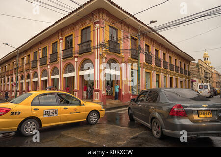 July 10, 2017 Buga, Valle de Cauca, Colombia: midday traffic can get congested on the narrow streets of the colonial - Stock Photo