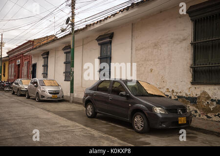 July 10, 2017 Buga, Coombia: the windshield of parked cars are covered with cardboard to protecrt against the tropical - Stock Photo