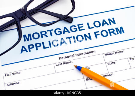 Mortgage Loan application form with ballpoint pen and glasses - Stock Photo