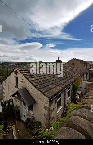 Quaint terraced cottages in the historic village of Haworth, West Yorkshire, England, UK. - Stock Photo
