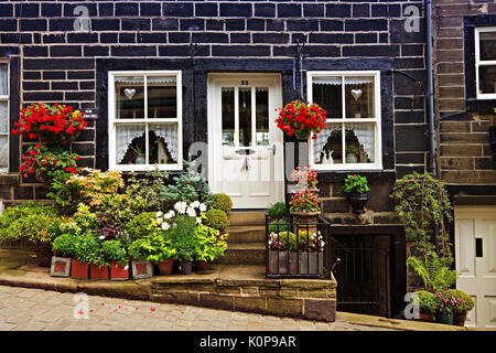 Quaint terraced cottage in the historic village of Haworth, West Yorkshire, England, UK. - Stock Photo