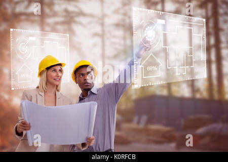 Man gesturing while standing with female architect against construction worker working at site - Stock Photo