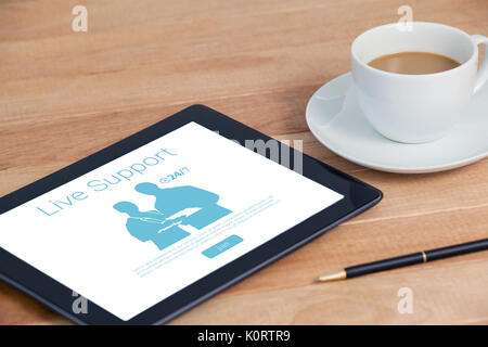 Live support text with human representations against digital tablet with pen and cup of tea - Stock Photo