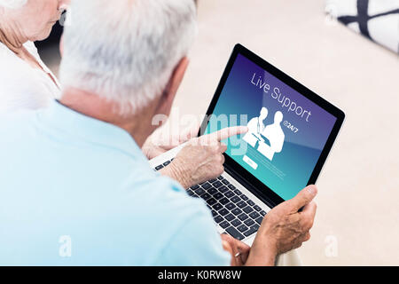 Human representations with live support text against focused senior couple using laptop - Stock Photo