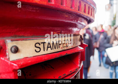 Red mail box in London. Landscape format. - Stock Photo