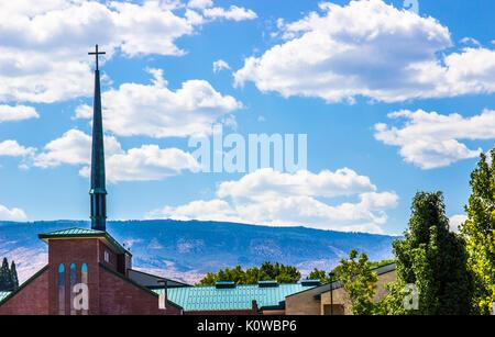 Tall Church Steeple Against Blue Sky Background - Stock Photo
