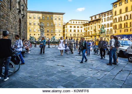 A bride and guests enter the Palazzo Vecchio in Florence Italy on the way to a wedding ceremony - Stock Photo
