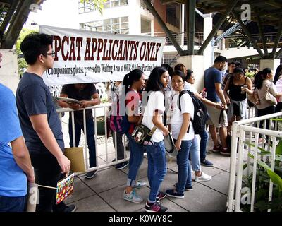 QUEZON CITY, PHILIPPINES - AUGUST 16, 2017: Students line up to submit their application form for the college entrance - Stock Photo