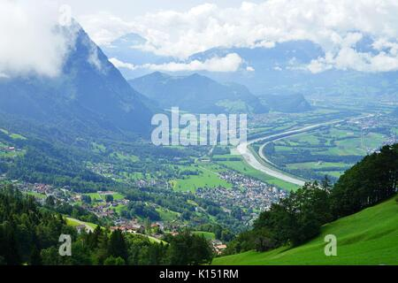 View of the Rhine Valley in the Alps between Liechtenstein and Switzerland - Stock Photo