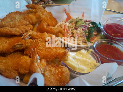 Fried Shrimp Basket with Coleslaw and Condiments - Stock Photo
