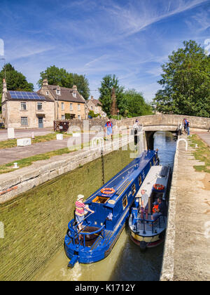 7 Jully 2017: Bradford on Avon, Somerset, England, UK - Two narrowboats passing through a lock on the Kennet and - Stock Photo