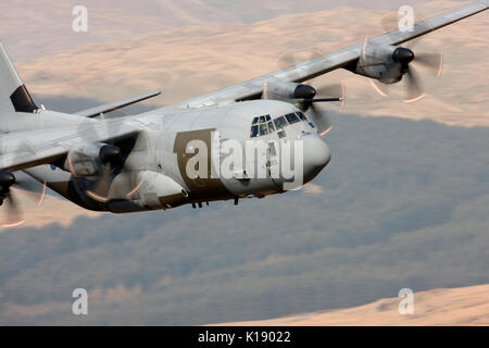 ZH883 RAF  Lockheed Martin C-130J Hercules Low level at Cad West Mach loop Wales - Stock Photo