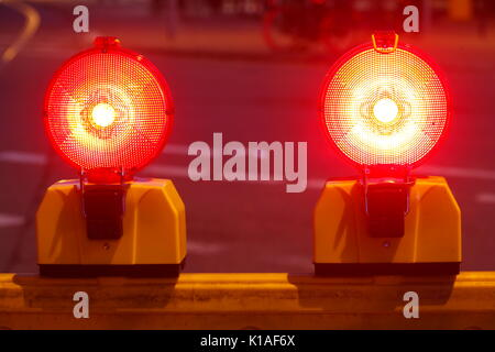 Flashing lights on a road barrier, construction site at dusk, Bremen, Germany, Europe - Stock Photo