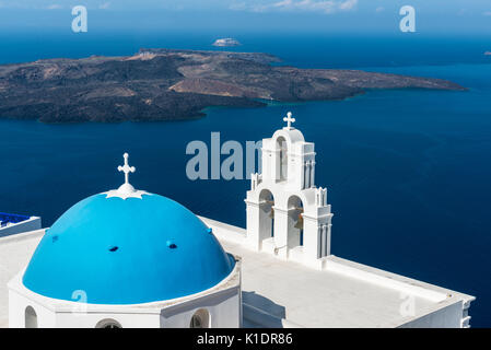 Church, blue Dome and bell tower, Firostefani, Santorini, Cyclades, Greece - Stock Photo