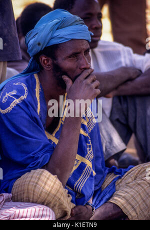 Niger, Doutouel Village, West Africa.  Young Man in   Adult Literacy Class. - Stock Photo