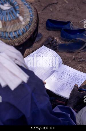 Niger, Doutouel Village, West Africa.  Notebook of Man Attending Adult Literacy Class. - Stock Photo