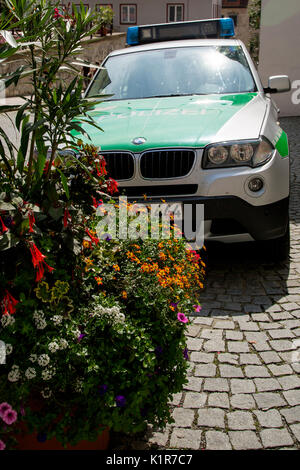 A BMW police car parked on a street in Fussen in Allgau, Bavaria, Germany, Europe - Stock Photo