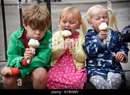 Limerick County Clare  Ireland Children eating ice cream at Bunratty Castle. - Stock Photo