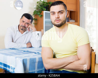 Domestic quarrel between mature father and  son - Stock Photo