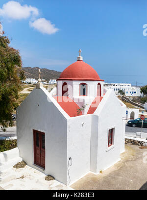 Little white church with a red roof, Ano Mera, Mykonos, Greece. - Stock Photo