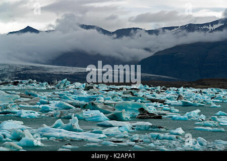Floating icebergs in the glacial lake Jokulsarlon - Iceland - Stock Photo