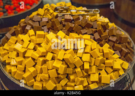 Picture of assorted delicious caramel bars in bown in a candy store - Stock Photo