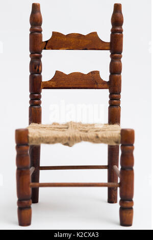 Old vintage wooden retro classic small brown handmade coiled carved elegant chair with decorative elements on white - Stock Photo