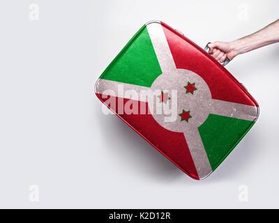 Burundi flag on a vintage leather suitcase. - Stock Photo